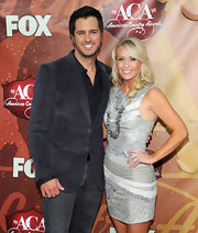 This gorgeous dress with lace and shirred panels really brought out Caroline's matching gray eyes.