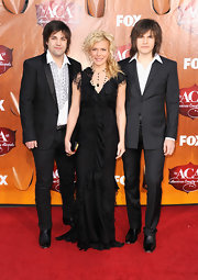 Kimberly Perry and her brothers Neil and Reid were another favorite group to attend the ACAs. While Kimberly looked perfectly lovely in her black ruffled gown, all eyes were on Reid and his statement shag 'do.