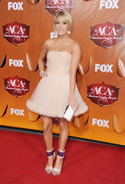 Carrie Underwood made a statement with her killer heels at the ACAs in Las Vegas. The style darling topped off her fun and flirty ensemble with purple accented strappy sandals complete with thick ankle straps.