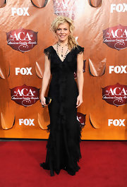 Kimberly Perry accented her ruffled black gown with a simply chic black satin clutch with gold hardware.