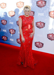 Lauren Alaina attended the American Country Awards wearing a beaded red gown by Jovani.