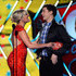 Presenters Lauren Alaina (L) and Scotty McCreery speak onstage during the American Country Awards 2013 at the Mandalay Bay Events Center on December 10, 2013 in Las Vegas, Nevada.