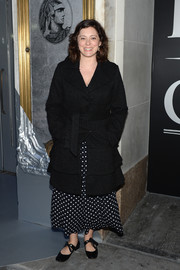 Rachel Bloom arrived for the American Express Platinum Card celebration wearing a black tweed coat over a polka-dot dress.