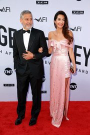 Amal Clooney went for sweet glamour in a bowed pink off-the-shoulder gown by Prada at the 2018 AFI Life Achievement Award Gala.
