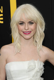Taryn Manning showed off her new platinum blond locks, styled with piecey waves and choppy bangs, at the 'American Hustle' premiere in NYC.