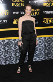 Erin Cummings was breezy yet sophisticated in a strapless black jumpsuit when she attended the 'American Hustle' premiere in NYC.