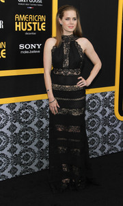 We're totally gushing over Amy Adams' black Elie Saab gown, featuring alternating lace and solid panels, at the 'American Hustle' premiere in NYC.