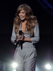 Jennifer paired her silver jumpsuit, with a hand full of silver rings.