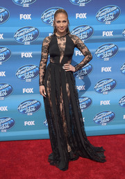 Jennifer Lopez continued her sheer red carpet run with this black lace-panel bodysuit by Zuhair Murad at the 'American Idol' XIV grand finale.
