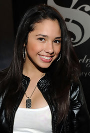 Jasmine sparkled in the American Music Awards Luxury Lounge thanks to a bejeweled dog tag necklace and matching hoops.