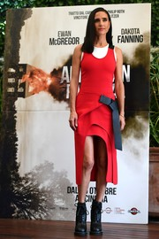 Jennifer Connelly rocked a modern vibe in this bow-adorned red mullet dress by Louis Vuitton at the 'American Pastoral' photocall in Rome.