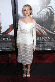 Sienna Miller looked very fashion-forward at the 'American Sniper' premiere in a sheer white Balenciaga off-the-shoulder dress with a crisscross bodice and long sleeves.