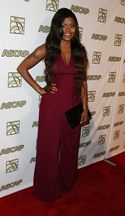 Karen Civil stunned in a burgundy jumpsuit that featured wide, flowing legs.