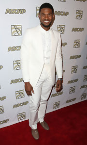 Usher looked dapper as every when he wore this crisp white suit.