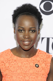 Lupita Nyong'o attended the Tony Awards Meet the Nominees press junket wearing her natural curls with a headband.