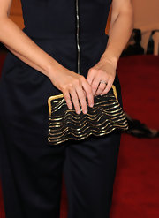 Tina Fey rocked one of the hottest embellishments of the season, the zipper. Her zipper clad clutch was the perfect accent to her zip-up romper.