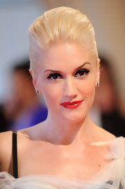 Gwen Stefani made a departure from her signature red lips in shiny mauve lipstick. The softer look perfectly complemented a sophisticated updo.