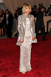 Anna was radiant in a Spring/Summer 2010 Haute Couture silk dress topped off with a sparkling sequined jacket.