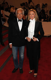 Ralph Lauren paired his distressed jeans with a tuxedo jacket and bowtie.