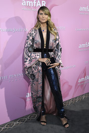 Heidi Klum went for exotic glamour in an embroidered pink kimono by Naeem Khan at the amfAR Gala in Paris.