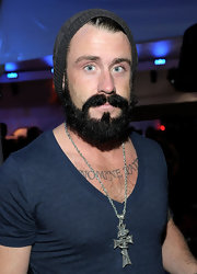 Brian Wilson paired his V-neck T-shirt with a silver cross pendent necklace and knit beanie.