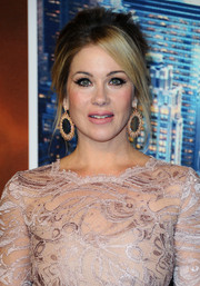 Christina Applegate infused some sexiness into her look via this Brigitte Bardot-inspired updo at the premiere of 'Anchorman 2.'