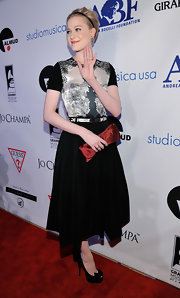 Evan Rachel Wood added a festive splash of color to her sophisticated dress with a burgundy satin clutch.