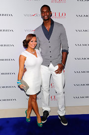 Adrienne Williams added a nice pop of color to her outfit with a pair of green platform peep-toes.
