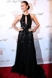 Irina dazzled at the Angel Ball in this black keyhole dress.