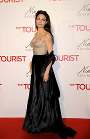 Angelina Jolie wears a matching black velvet shawl to 'The Tourist' premiere in Madrid.