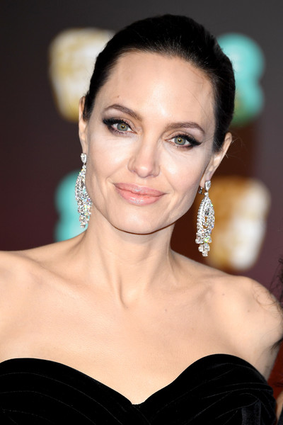 Angelina Jolie Classic Bun [eyebrow,beauty,jewellery,fashion model,human hair color,hairstyle,chin,eyelash,cheek,forehead,red carpet arrivals,angelina jolie,ee,england,london,royal albert hall,british academy film awards]
