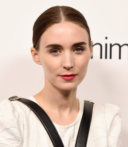 Rooney Mara gave her monochrome look a pop of color with a sweep of red lipstick.