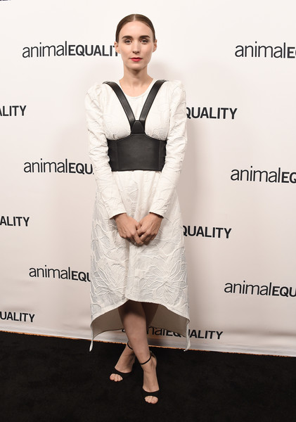 Rooney Mara donned a Hiraeth ensemble, consisting of a textured white midi dress and a black faux-leather harness belt, for the Animal Equality's Inspiring Global Action Gala.