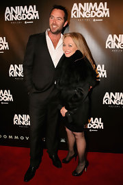 Jacki wears a fur stole over her black cocktail dress for the premiere of 'Animal Kingdom.'