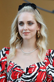Chiara Ferragni jazzed up her lobes with chunky gold hoops.