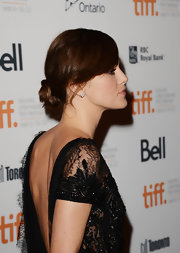 Keira tied her hair up in a soft-swept low bun to show off her brilliant backless gown.