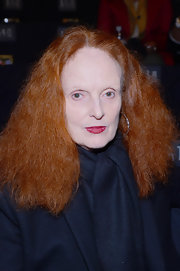 Grace Coddington attended  Anna Sui's Fall 2013 fashion show with her signature long red wavy hair.