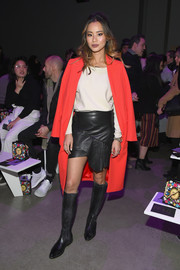 Jamie Chung matched her skirt with a pair of knee-high leather boots.