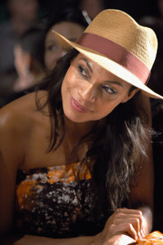 Rosario Dawson channeled summer with this straw hat at the Anna Sui fashion show.