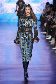 Blue velvet lace-up boots finished off Taylor Hill's runway look.