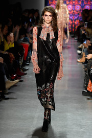 Kaia Gerber shimmered in a black sequin dress while walking the Anna Sui runway.