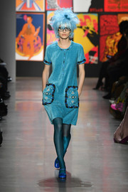 Taylor Hill sported a casual-chic teal mini dress at the Anna Sui runway show.