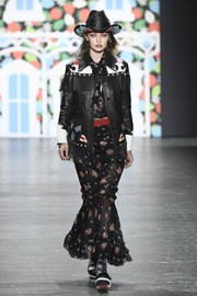 Gigi Hadid was Western-chic in a fringed leather jacket layered over an embroidered maxi dress while walking the Anna Sui runway.