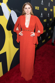 Amy Adams looked ravishing in a plunging red gown with split sleeves at the premiere of 'Vice.'