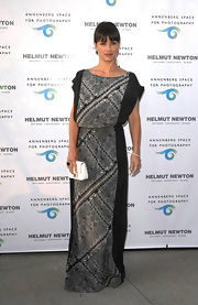 Constance Zimmer donned this black draped gown that featured a patterned gray panel.