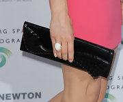 Crystal Reed sported this cool and contemporary leather clutch that featured studs.