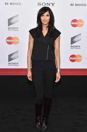 Padma Lakshmi went for a moto-chic vibe with this black zip-up top and slacks combo at the New York premiere of 'Annie.'