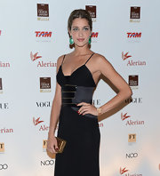 Ana Beatriz Barros complemented her ultra-chic dress with an elegant gold hard-case clutch when she attended the Brazil Foundation Gala.