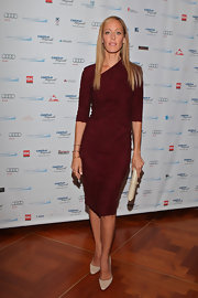 Kim Raver looked svelte in a red asymmetric neckline dress at the Annual Charity Day.