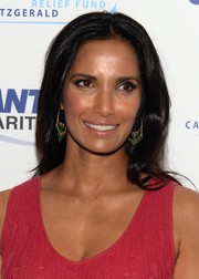 Padma Lakshmi accessorized her look with a pair of beaded hoop earrings.
